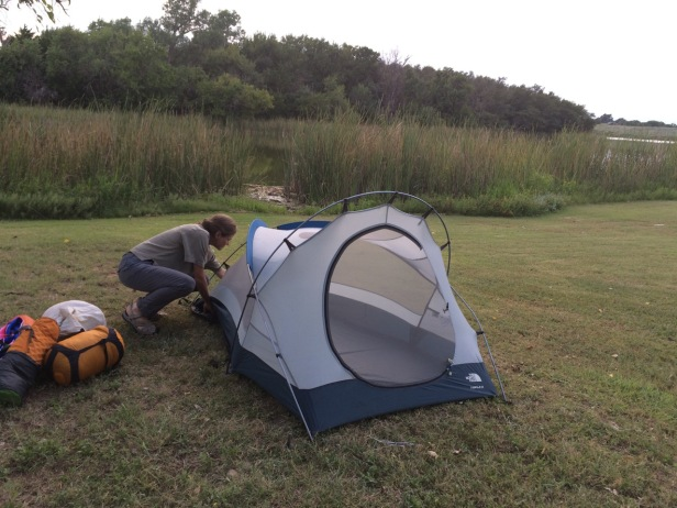A simple portable tent home felt like an airy burrow! Here's Sandra setting up the tent at Black Kettle National Grasslands in Oklahoma.