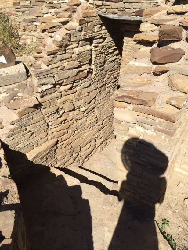 My shadow falls upon the stones as I explore Pueblo Bonito again--38 years later.